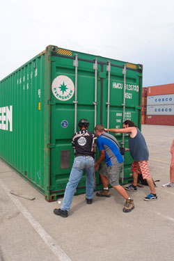 It takes three guys to close the door of our container