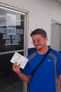 Kobus with his passport stamp so he can leave without the vehicle