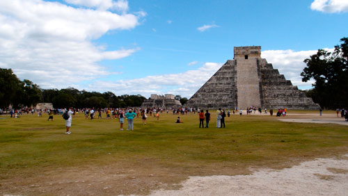 The pyramid at Chichen Itza, with a huge crowd of people.